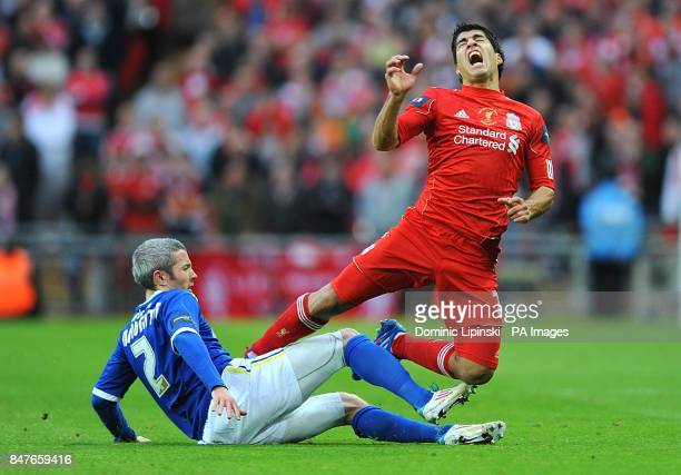 Liverpool's Luis Suarez reacts to a challenge from Cardiff City's Kevin McNaughton