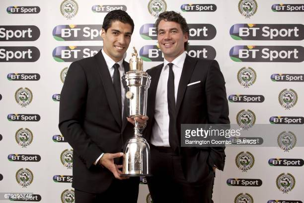 Liverpool's Luis Suarez receives the Player of the Year award alongside BT Group Chief Executive Gavin Patterson during the PFA Player of the Year...