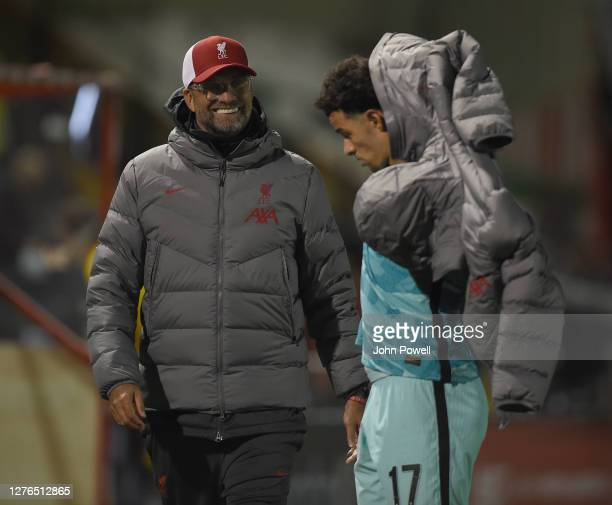 Liverpool's manager Jurgen Klopp and Liverpool's Curtis Jones at the End of the Carabao Cup Third Round Lincoln City V Liverpool at Sincil Bank...