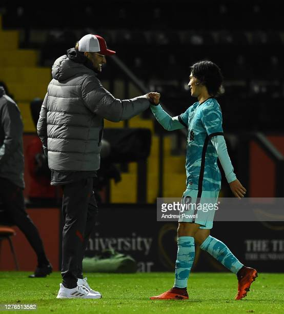 Liverpool's manager Jurgen Klopp and Liverpool's Takumi MinaMino at the End of the Carabao Cup Third Round Lincoln City V Liverpool at Sincil Bank...