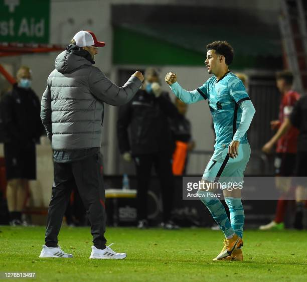 Liverpool's manager Jurgen Klopp with Cutis Jones at the end of the Carabao Cup third round match between Lincoln City and Liverpool at Sincil Bank...