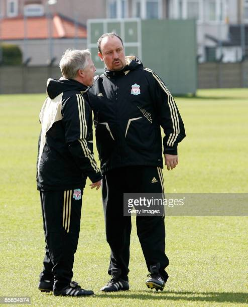 Liverpool's manager Rafael Benitez speaks to his assistant Sammy Lee during a Liverpool training session before their UEFA Champions League Quarter...