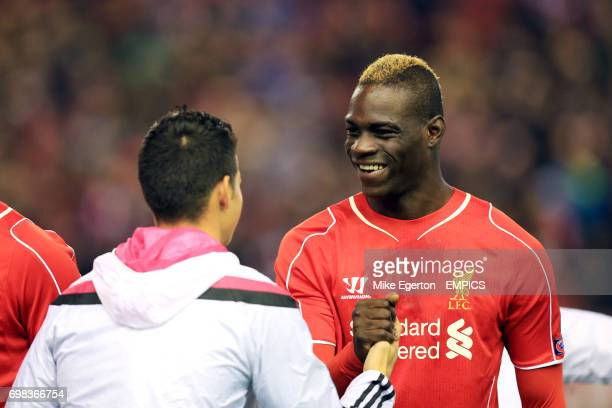 Liverpool's Mario Balotelli greets Real Madrid's James Rodriguez