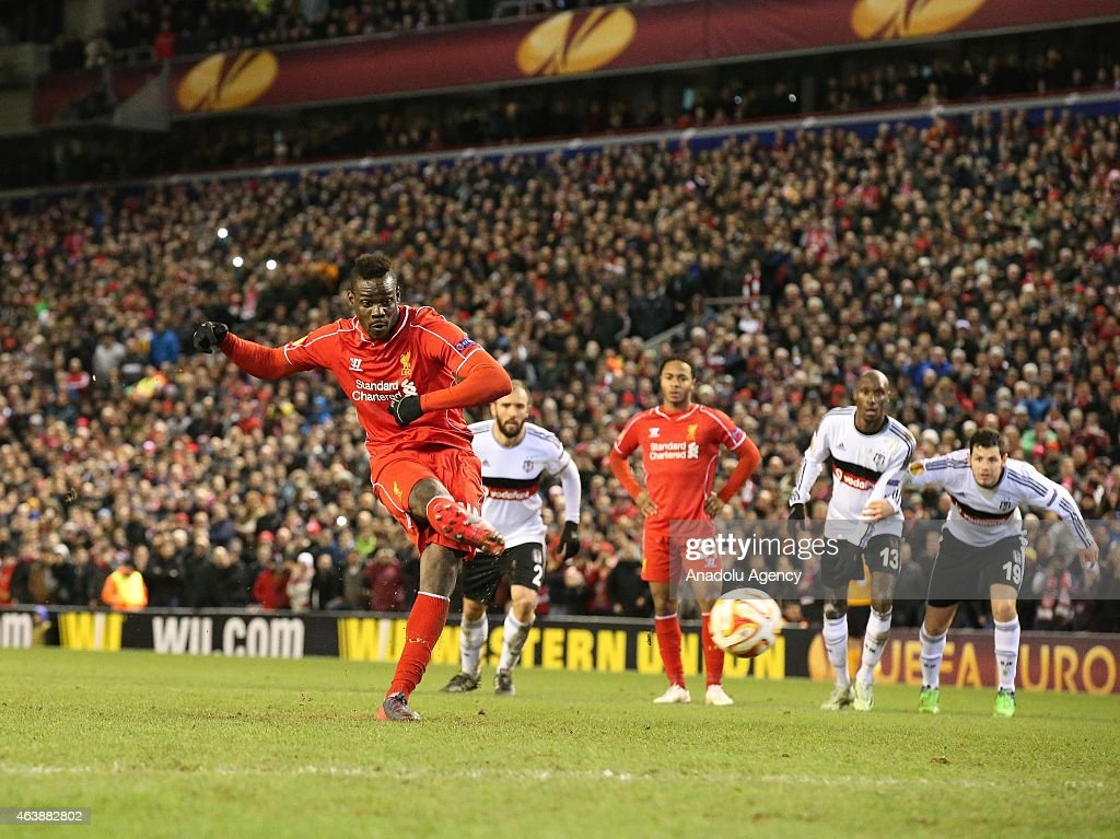 Liverpool's Mario Balotelli scores the opening goal against Besiktas JK from a penalty during the UEFA Europa League Round of 32 match between Liverpool and Besiktas at Anfield Stadium in Liverpool on February 19 2015.