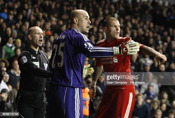 Liverpool's Martin Skrtel and Jose Reina protest to the referee's assistant