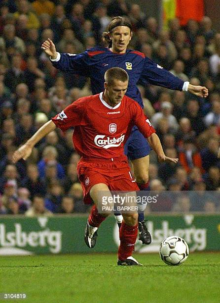 Liverpool's Michael Owen beats Portsmouth's Dejan Stefanovic during tonight's Premiership football match at Anfield, 17 March 2004. AFP PHOTO/ Paul...