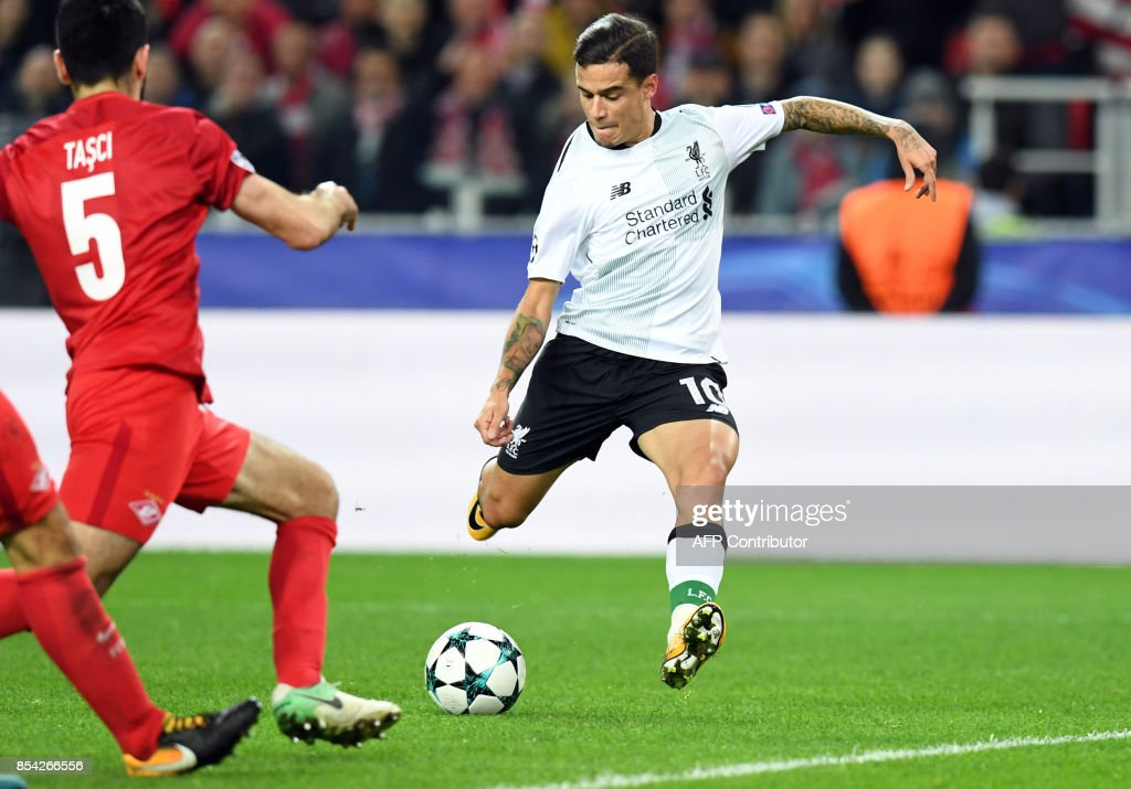 Liverpool's midfielder from Brazil Philippe Coutinho Correia shoots to score a goal during the UEFA Champions League Group E football match between FC Spartak Moscow and Liverpool FC at the Otkrytie Arena stadium in Moscow on September 26, 2017. / AFP PHOTO / Kirill KUDRYAVTSEV