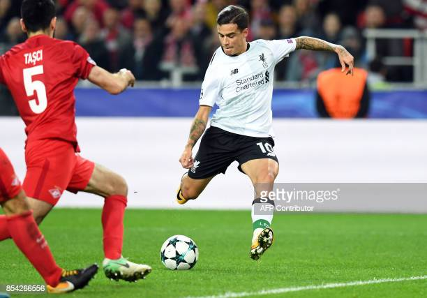 Liverpool's midfielder from Brazil Philippe Coutinho Correia shoots to score a goal during the UEFA Champions League Group E football match between...