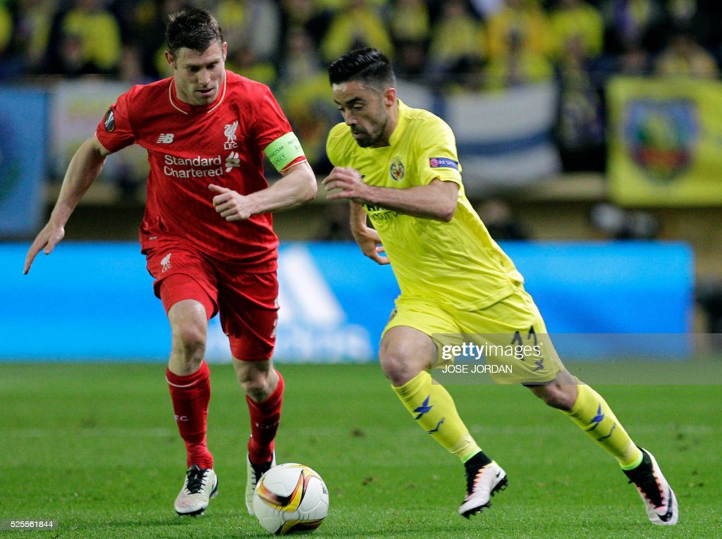 Liverpool's midfielder James Milner (L) vies with Villarreal's midfielder Jaume Costa during the UEFA Europa League semifinals first leg football match Villarreal CF vs Liverpool FC at El Madrigal stadium in Vila-real on April 28, 2016. / AFP PHOTO / JOSE JORDAN / The erroneous mention[s] appearing in the metadata of this photo by JOSE JORDAN has been modified in AFP systems in the following manner: [Liverpool's midfielder James Milner (L)] instead of [Liverpool's defender Nathaniel Clyne (L)]. Please immediately remove the erroneous mention[s] from all your online services and delete it (them) from your servers. If you have been authorized by AFP to distribute it (them) to third parties, please ensure that the same actions are carried out by them. Failure to promptly comply with these instructions will entail liability on your part for any continued or post notification usage. Therefore we thank you very much for all your attention and prompt action. We are sorry for the inconvenience this notification may cause and remain at your disposal for any further information you may require.