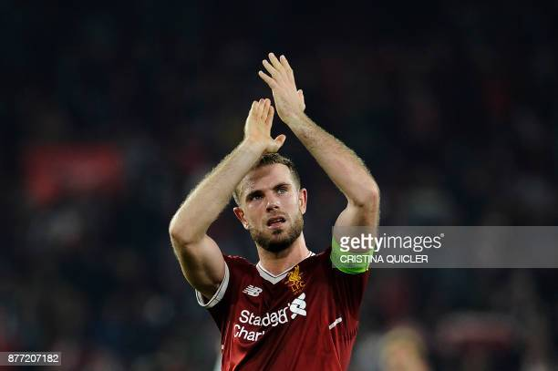 Liverpool's midfielder Jordan Henderson applauds on November 21 2017 at the Ramon Sanchez Pizjuan stadium in Sevilla after the UEFA Champions League...