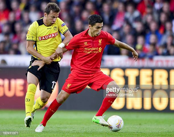 Liverpool's midfielder Nuri Sahin vies for the ball with Young Boys' defender Elsad Zverotic during the Europa League group A football match between...