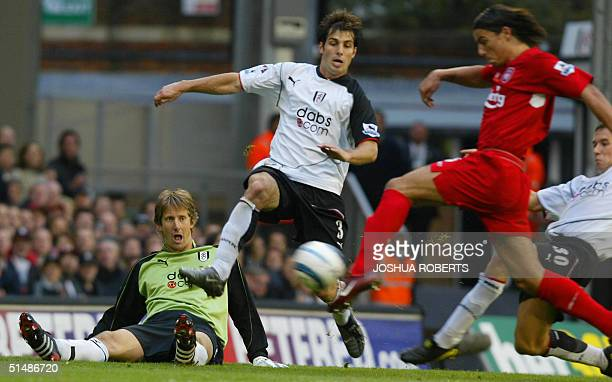 Liverpool's Milan Baros scores as Fulham's Carlos Bocanegra tries to cleart the ball after goalkeeper Edwin van der Sar lost control of the ball...