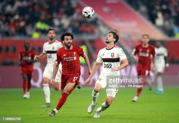 Liverpool's Mohamed Salah and Flamengo's Rodrigo Caio battle for the ball during the FIFA Club World Cup final at the Khalifa International Stadium...