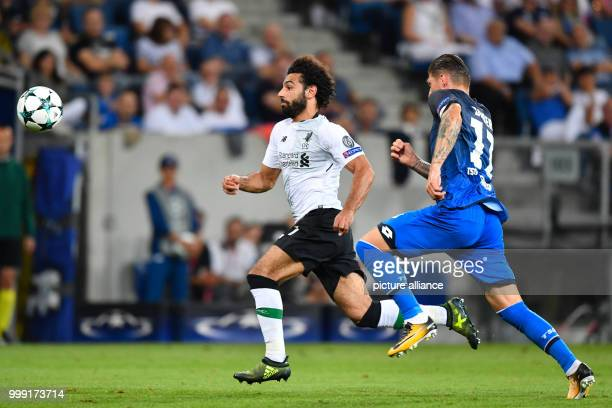 Liverpool's Mohamed Salah and Hoffenheim's Steven Zuber vie for the ball during the Champions League's qualifer match between 1899 Hoffenheim and FC...