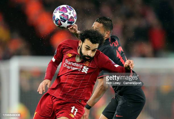 Liverpool's Mohamed Salah battles with Atletico Madrid's Renan Lodi during the UEFA Champions League round of 16 second leg match between Liverpool...