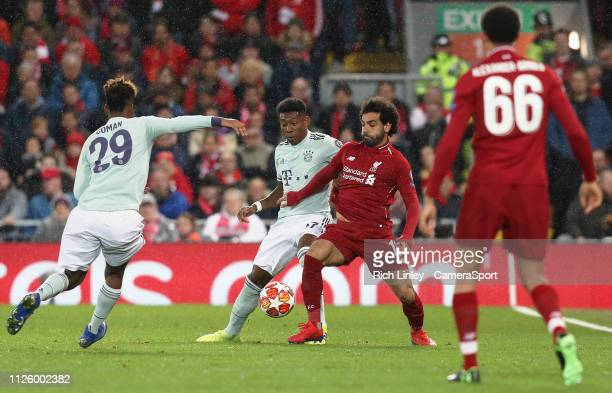 Liverpool's Mohamed Salah battles with Bayern Munich's Jonathan Meier during the UEFA Champions League Round of 16 First Leg match between Liverpool...