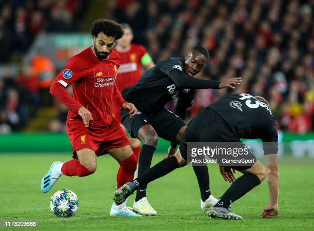 Liverpool's Mohamed Salah beats Red Bull Salzburg's Enock Mwepu and Rasmus Kristensen during the UEFA Champions League group E match between...