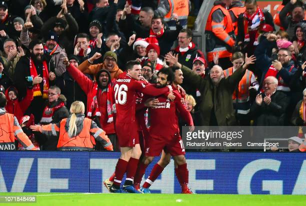Liverpool's Mohamed Salah celebrates scoring his side's first goal with his teammates during the UEFA Champions League Group C match between...