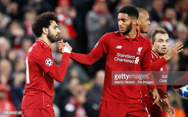 Liverpool's Mohamed Salah celebrates scoring his side's second goal of the game with Joe Gomez during the UEFA Champions League Group C match at...