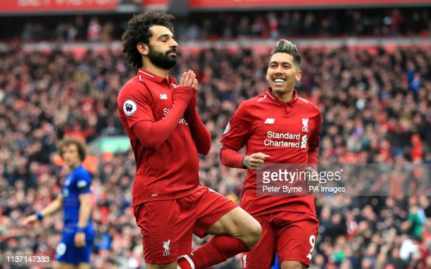 Liverpool's Mohamed Salah celebrates scoring his side's second goal of the game with Roberto Firmino during the Premier League match at Anfield...