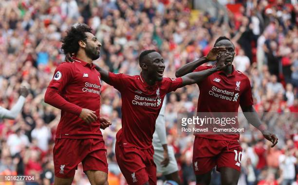 Liverpool's Mohamed Salah celebrates scoring his side's second goal with Naby Keita and Sadio Mane during the Premier League match between Liverpool...