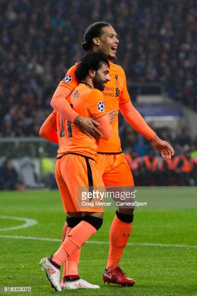 Liverpool's Mohamed Salah celebrates scoring his side's second goal with team mate Virgil van Dijk during the UEFA Champions League Round of 16 First...