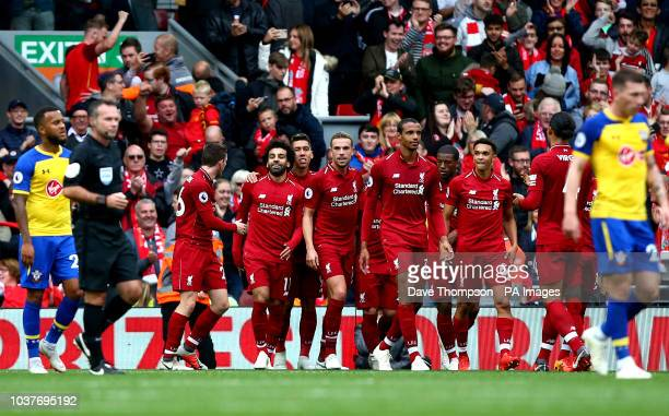 Liverpool's Mohamed Salah celebrates scoring his side's third goal of the game during the Premier League match at Anfield Liverpool