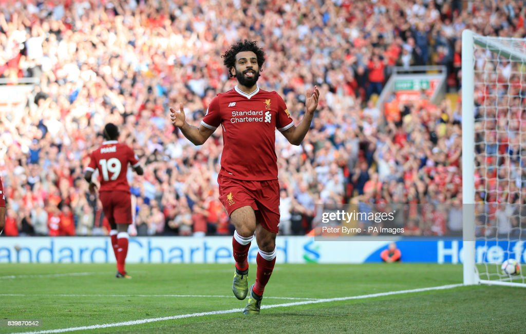 Liverpool's Mohamed Salah celebrates scoring his side's third goal of the game during the Premier League match at Anfield, Liverpool.