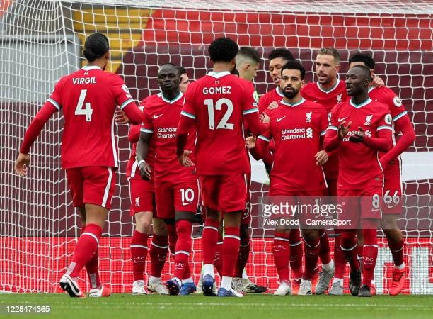 Liverpool's Mohamed Salah celebrates scoring the opening goal with teammates during the Premier League match between Liverpool and Leeds United at...