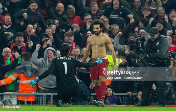 Liverpool's Mohamed Salah celebrates scoring the second goal with Alisson Becker during the Premier League match between Liverpool FC and Manchester...