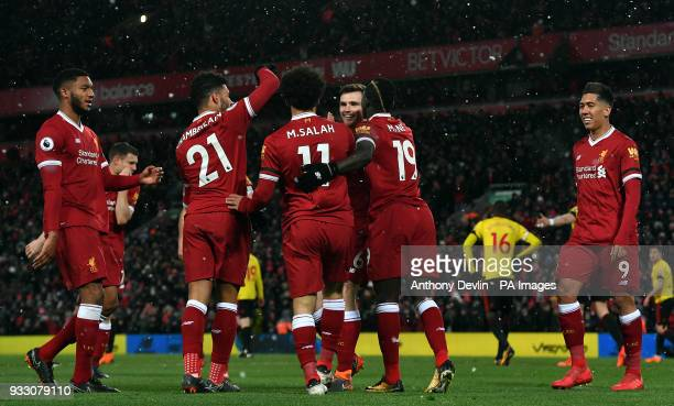 Liverpool's Mohamed Salah celebrates with Alex OxladeChamberlain and Sadio Mane after scoring a hattrick during the Premier League match at Anfield...