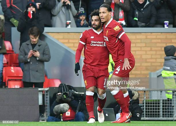 Liverpool's Mohamed Salah celebrates with Liverpool's Virgil van Dijk after scoring the games first goal during the Premier League match at Anfield...