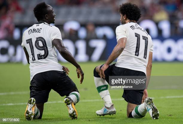 Liverpool's Mohamed Salah celebrates with Sadio Mane scoring the 02 during the Audi Cup semifinal pitting FC Bayern Munich vs FC Liverpool at the...