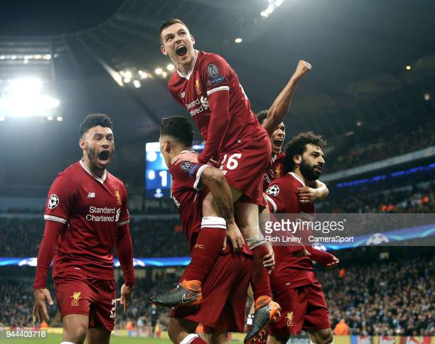 Liverpool's Mohamed Salah celebrates with team mates after scoring his side's equalising goal to make the score 1 1 during the UEFA Champions League...