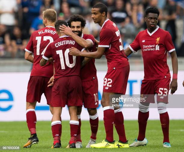 Liverpool's Mohamed Salah celebrates with teammates after giving his side a 30 lead during the international club friendly soccer match between...