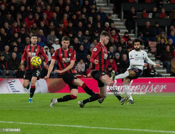 Liverpool's Mohamed Salah crosses the ball despite the attentions of the Bournemouth player during the Premier League match between AFC Bournemouth...