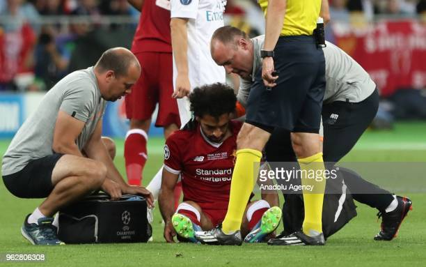 Liverpool's Mohamed Salah gets injured during the UEFA Champions League final football match between Real Madrid and Liverpool FC at the Olimpiyskiy...