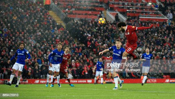 Liverpool's Mohamed Salah has a header on goal during the Premier League match at Anfield Liverpool