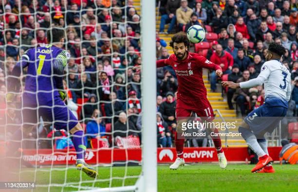 Liverpool's Mohamed Salah heads across goal before Tottenham Hotspur's Hugo Lloris fumbled the ball leading to an own goal from Toby Alderweireld...