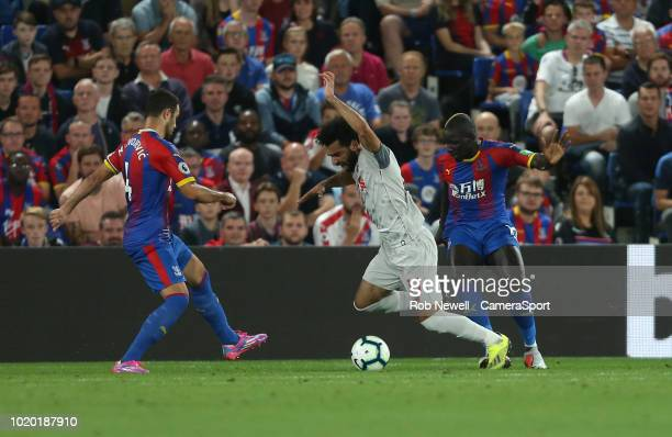 Liverpool's Mohamed Salah is brought down by Crystal Palace's Mamadou Sakho to earn his side a first half penalty during the Premier League match...