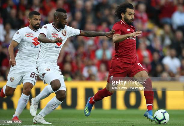 Liverpool's Mohamed Salah is chased by Torino's Nicolas N'Koulou and Armando Izzo during the preseason match at Anfield Liverpool