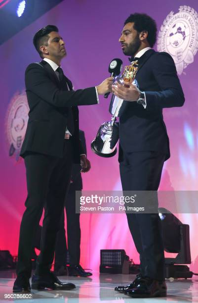 Liverpool's Mohamed Salah is presented with the PFA Player Of The Year Award during the 2018 PFA Awards at the Grosvenor House Hotel London PRESS...