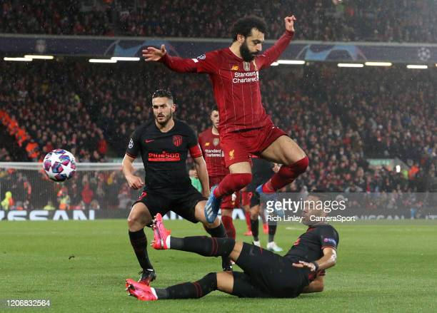 Liverpool's Mohamed Salah is tackled by Atletico Madrid's Renan Lodi during the UEFA Champions League round of 16 second leg match between Liverpool...