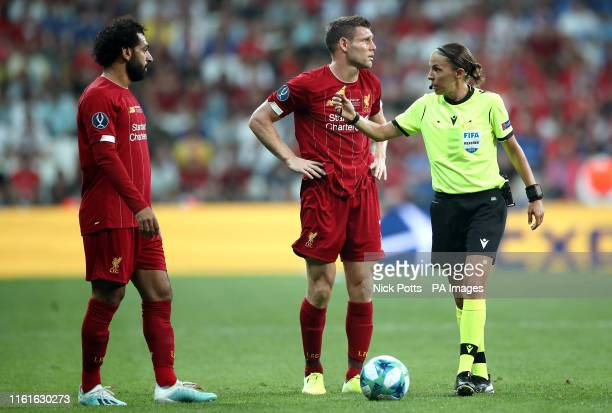 Liverpool's Mohamed Salah James Milner and match referee Stephanie Frappart during the UEFA Super Cup Final at Besiktas Park Istanbul