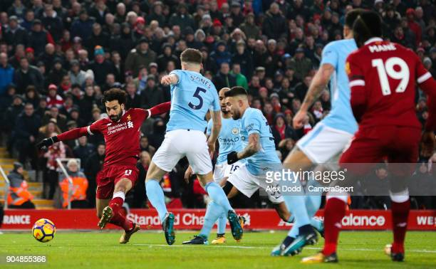 Liverpool's Mohamed Salah pokes an effort just wide during the Premier League match between Liverpool and Manchester City at Anfield on January 14...