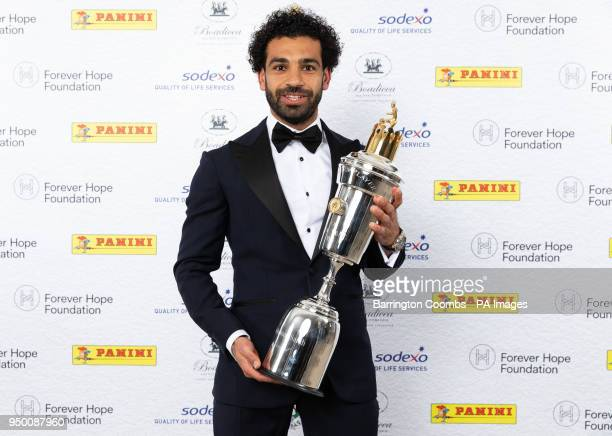 Liverpool's Mohamed Salah poses with the PFA Player Of The Year Award Trophy during the 2018 PFA Awards at the Grosvenor House Hotel London