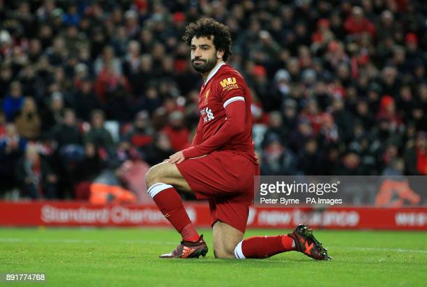 Liverpool's Mohamed Salah reacts to a miss during the Premier League match at Anfield Liverpool