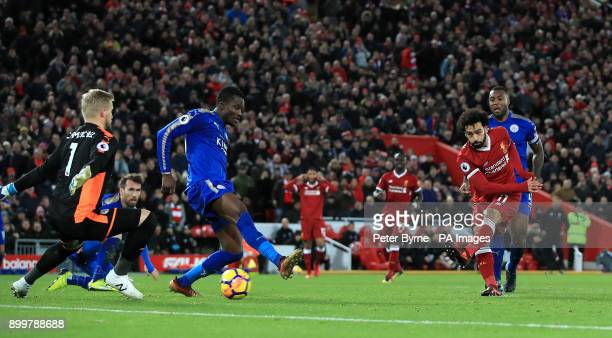 Liverpool's Mohamed Salah scores his side's first goal during the Premier League match at Anfield Liverpool