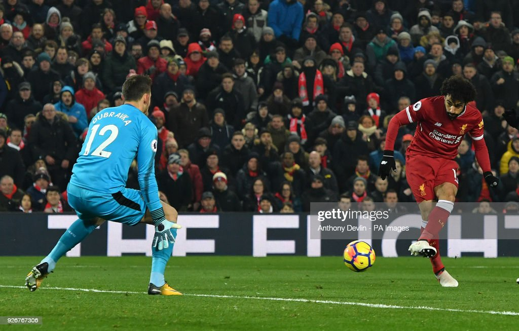 Liverpool's Mohamed Salah scores his side's first goal of the game during the Premier League match at Anfield, Liverpool.
