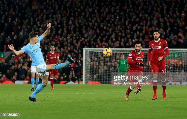 Liverpool's Mohamed Salah scores his side's fourth goal of the game during the Premier League match at Anfield Liverpool